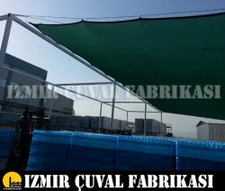 İZMİR ÇUVAL FABRİKASI - 5 x 10 mt GÖLGELİK FİLE KENARLARI DİKİMLİ HALKALI